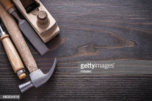 Horizontal view of claw hammer wooden shaving plane and flat : Stock Photo