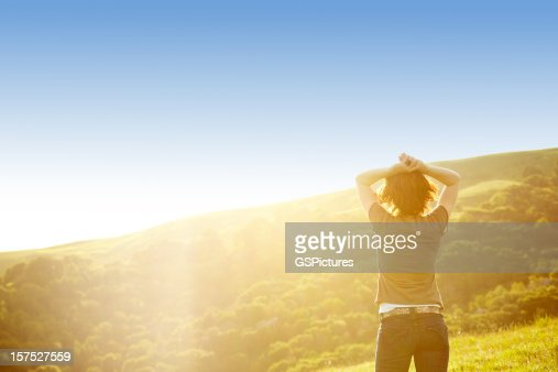 Horizontally framed shot of woman in rural setting : Stock Photo