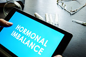 Hormonal imbalance sign on a tablet.