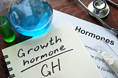 Hormone  written growth hormone on notebook. Test tubes and hormones list.