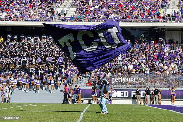 Horned Frogs flag runner waves a giant TCU flag after a touchdown during the game between the TCU Horned Frogs and the Texas Tech Red Raiders on...