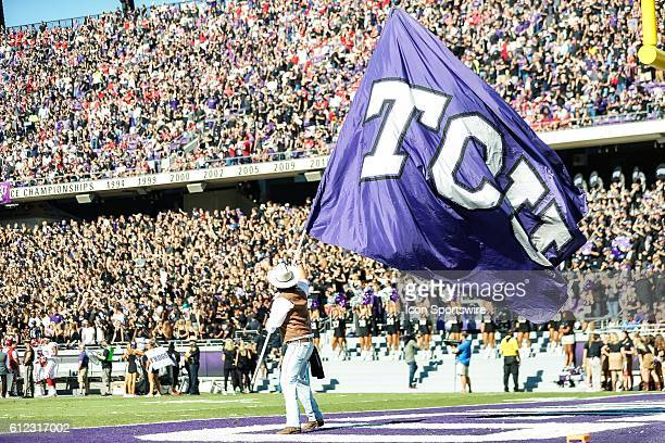 Horned Frogs flag runner waves a giant TCU flag during the game between the TCU Horned Frogs and the Oklahoma Sooners at Amon G Carter Stadium in...