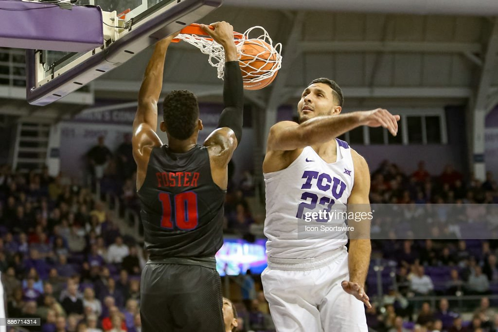 TCU Horned Frogs forward Ahmed Hamdy-Mohamed (23) misses his attempt to block a dunk by Southern Methodist Mustangs guard Jarrey Foster (10) during the game between the SMU Mustangs and TCU Horned Frogs on December 5, 2017 at Ed & Rae Schollmaier Arena in Fort Worth, TX.