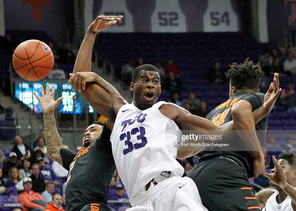 TCU Horned Frogs forward Chris Washburn (33) is tied up under the basket by OSU defenders during the first half on Monday, Feb. 8, 2016, at Ed & Rae Schollmaier Arena in Fort Worth, Texas.