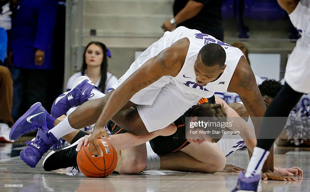 TCU Horned Frogs forward Devonta Abron (23) dives over Oklahoma State Cowboys forward Mitchell Solomon (41) for a loose ball during the first half on Monday, Feb. 8, 2016, at Ed & Rae Schollmaier Arena in Fort Worth, Texas.
