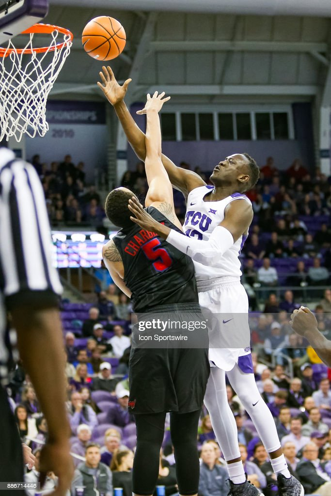 TCU Horned Frogs forward Kouat Noi (12) shoots over Southern Methodist Mustangs forward Ethan Chargois (5) during the game between the SMU Mustangs and TCU Horned Frogs on December 5, 2017 at Ed & Rae Schollmaier Arena in Fort Worth, TX.