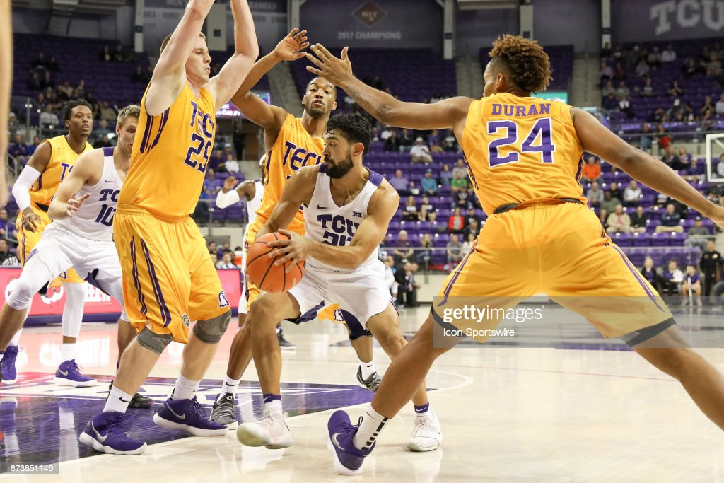 TCU Horned Frogs guard Alex Robinson (25) is surrounded by Tennessee Tech Golden Eagles during the game between the Tennessee Tech Golden Eagles and TCU Horned Frogs on November 13, 2017 at Ed & Rae Schollmaier Arena in Fort Worth, TX.