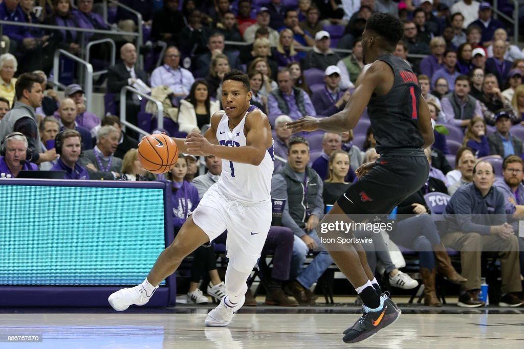TCU Horned Frogs guard Desmond Bane (1) drives on Southern Methodist Mustangs guard Shake Milton (1) during the game between the SMU Mustangs and TCU Horned Frogs on December 5, 2017 at Ed & Rae Schollmaier Arena in Fort Worth, TX.