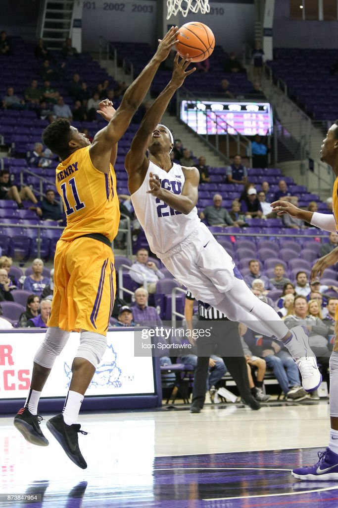 TCU Horned Frogs guard RJ Nembhard (22) has his shot blocked by Tennessee Tech Golden Eagles center Micaiah Henry (11) during the game between the Tennessee Tech Golden Eagles and TCU Horned Frogs on November 13, 2017 at Ed & Rae Schollmaier Arena in Fort Worth, TX.