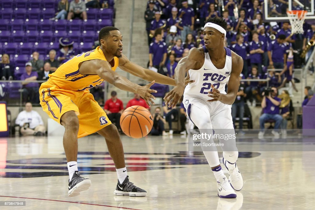 TCU Horned Frogs guard RJ Nembhard (22) makes a bounce pass around Tennessee Tech Golden Eagles forward Curtis Phillips Jr. (15) during the game between the Tennessee Tech Golden Eagles and TCU Horned Frogs on November 13, 2017 at Ed & Rae Schollmaier Arena in Fort Worth, TX.