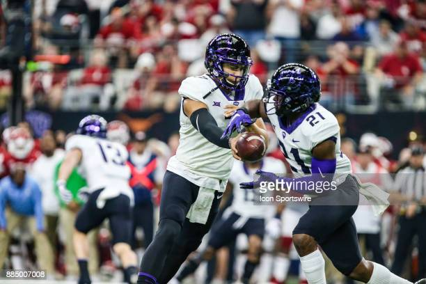 Horned Frogs quarterback Kenny Hill handsoff the football to running back Kyle Hicks during the game between the Oklahoma Sooners and the TCU Horned...