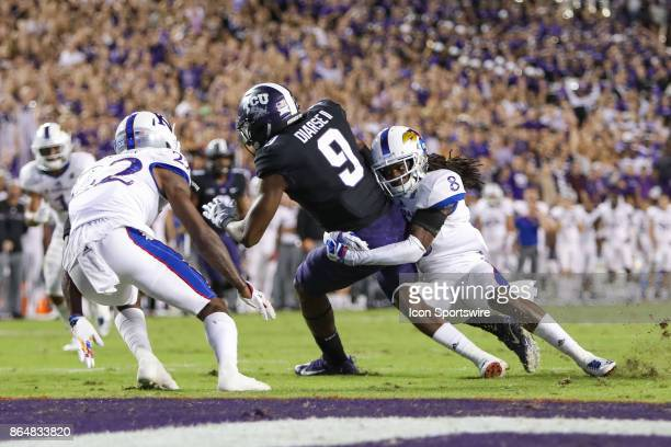 Horned Frogs wide receiver John Diarse is tackled just short of the goal line by Kansas Jayhawks cornerback Shakial Taylor during the football game...