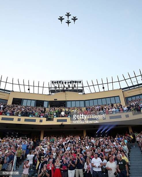 Hornets from US Navy Strike Fighter Squadron 34 perform a flyover during opening ceremonies for the 2016 Invictus Games in Orlando Florida May 8 2016...
