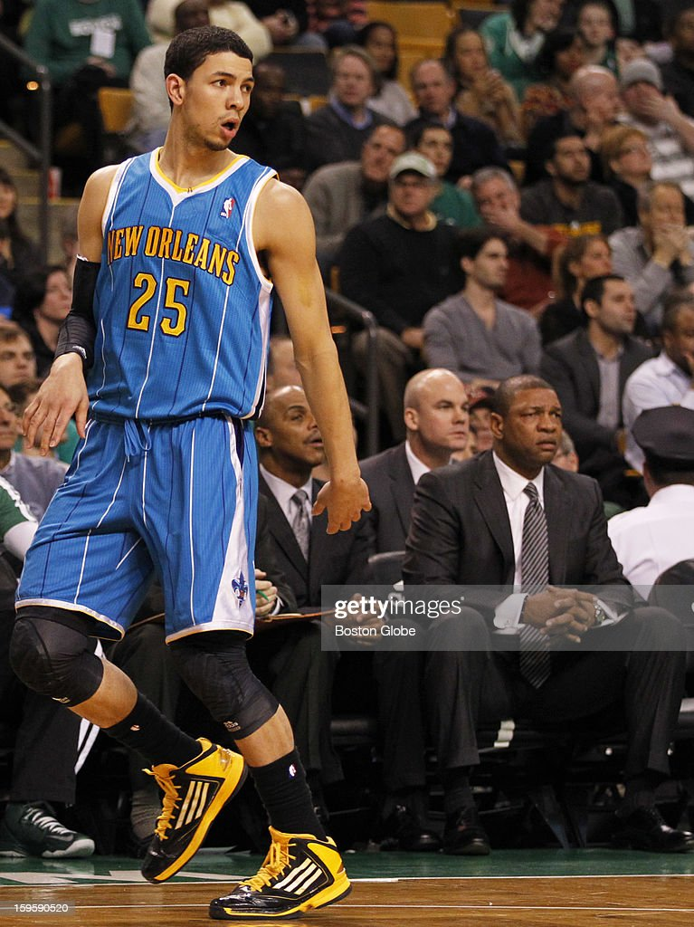 Hornets guard Austin Rivers (#25) runs by the Boston bench with dad and coach Doc Rivers watching in the first quarter as the Boston Celtics play the New Orleans Hornets in a regular season NBA game at TD Garden in Boston, Mass. on Wednesday, Jan. 16, 2013.