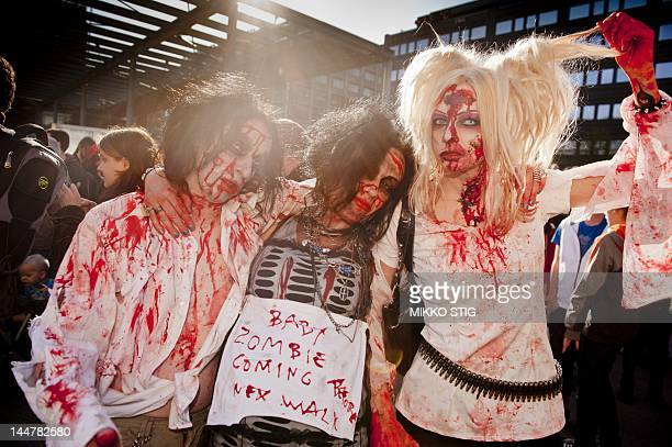Horror movie enthusiasts dressed as zombies take part in the Helsinki Zombie Walk in Central Helsinki on May 19 2012 AFP PHOTO / LEHTIKUVA / Mikko...