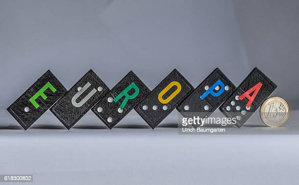 Horror scenario Symbol photo on the future of Europe and a possible domino effect The photo shows Domino stones with the lettering Europe and a 1...