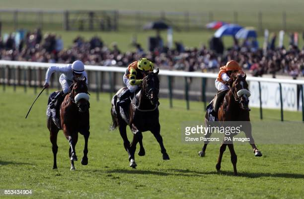 Hors De Combat ridden by Frederik Tylicki wins the Qipco Supports racing Welfare handicap stakes during day one of the 2014 QIPCO Guineas Festival at...