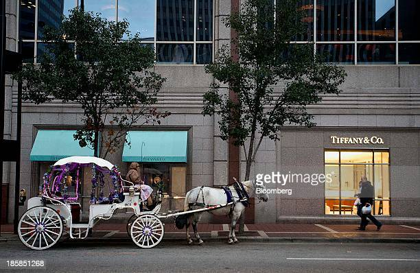 A horse and buggy sits parked outside of Tiffany and Co store in Cincinnati Ohio US on Thursday Oct 24 2013 Consumer confidence in the US dropped in...