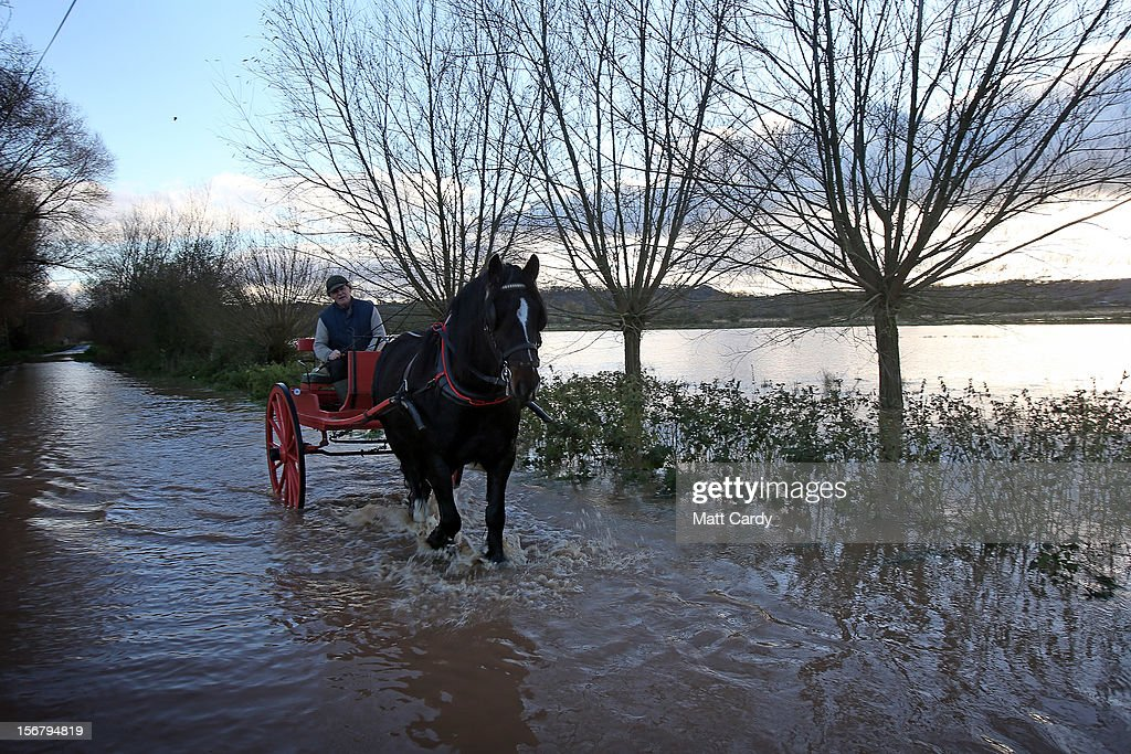 A horse and cart passes flooded fields and roads close to the village of North Curry on November 21, 2012 near Taunton, England. Heavy rain overnight has brought widespread disruption to many parts of the UK particularly in the Somerset and Wiltshire and weather forecasters have warned of more wet and windy weather to come.