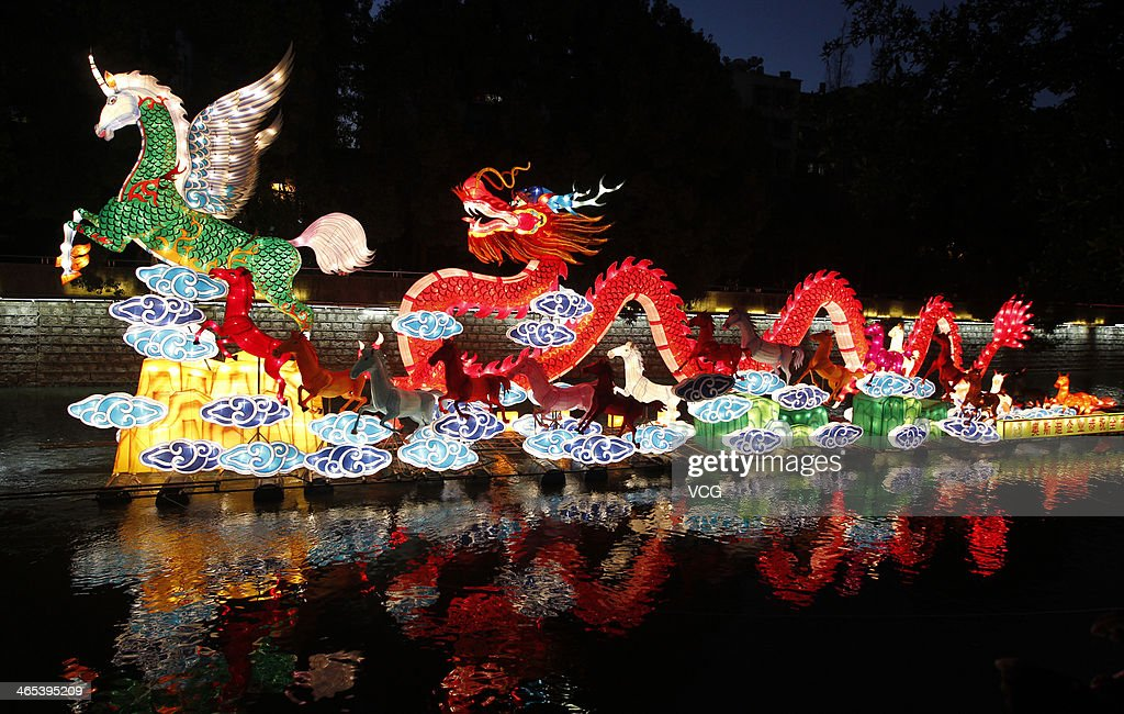 Horse and dragon lanterns are illuminated on Panlong River on January 26, 2014 in Kunming, China. Chinese people are preparing for the Spring Festival, the year of horse, which will fall on January 31 according to Chinese calendar.