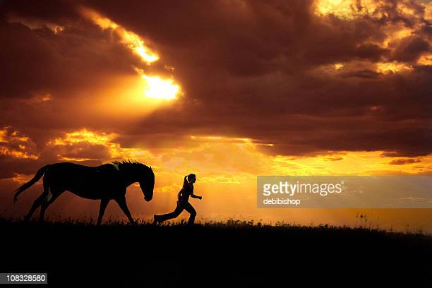 Horse And Girl Running At Sunset