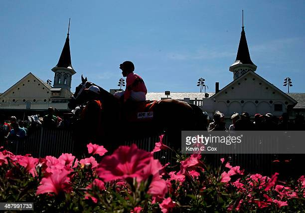 A horse and jockey walk past the twin spires prior to the 140th running of the Kentucky Derby at Churchill Downs on May 3 2014 in Louisville Kentucky