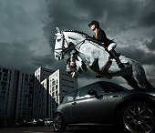 horse and rider jumping in urban surroundings