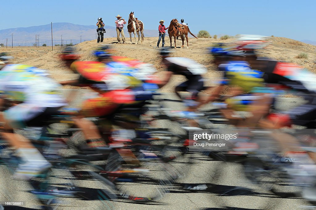 Horse and their riders watch as the peloton passed by during Stage Three of the 2013 Amgen Tour of California from Palmdale to Santa Clarita on May 14, 2013 in Palmdale, California.