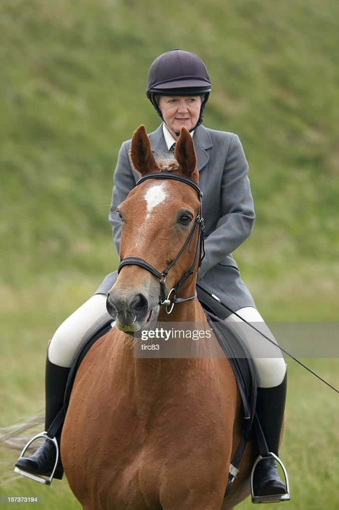 Horse and woman rider in dressage competition