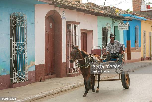 horse carriage at streets with traditional buildings of trinidad Cuba