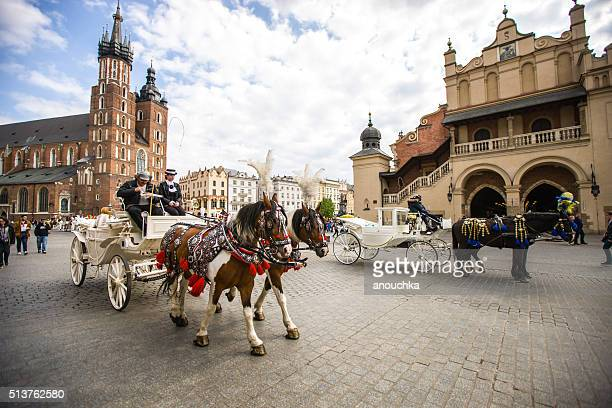 Horse carriage on Krakow main square, Poland
