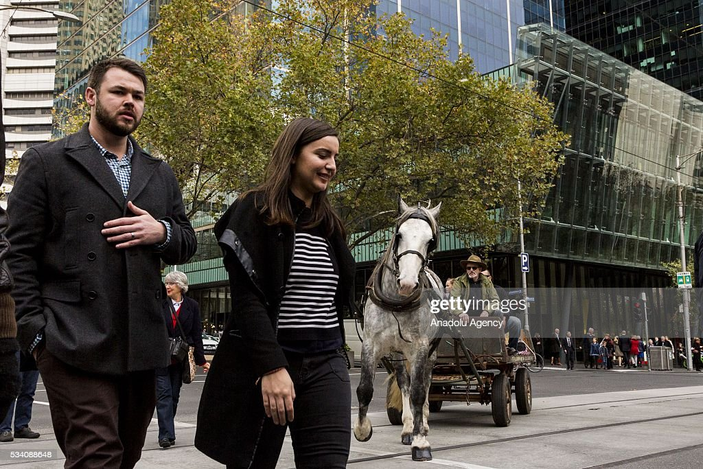 A horse cart is seen at city street during a protest demanding Australian government to solve the dairy crisis in Melbourne, Australia on May 25, 2016.