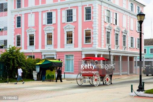 Horse cart moving on the road, Bay Street, Nassau, Bahamas
