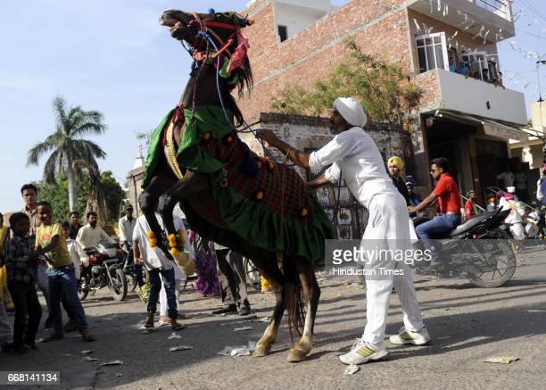 A horse dancing on the tunes of his master during the Nagar Kirtan on the occasion of Baisakhi festival on April 13 2017 in Patiala India Baisakhi is...