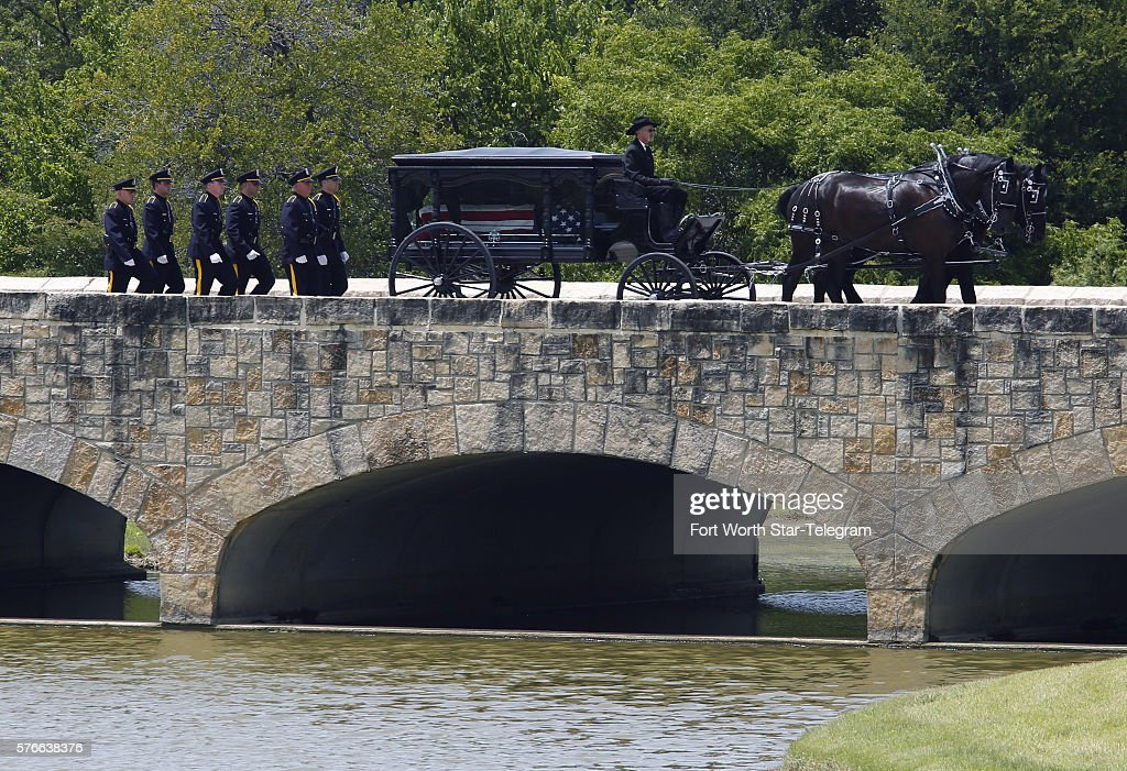 A horse drawn caisson arrives with the casket of Dallas Police officer Patrick Zamarripa at Dallas Fort Worth National Cemetery Saturday July 16 2016...