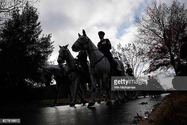 A horse drawn caisson carries the casket of US Army Staff Sgt Kevin J McEnroe during the soldier's burial service at Arlington National Cemetery...