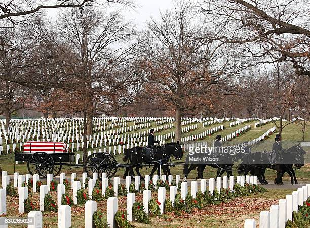 A horse drawn caisson carries the remains of Air Force Maj Troy Lee Gilbert during a full honor burial service at Arlington Cemetery December 19 2016...
