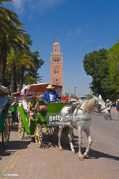 Horse drawn carriage and Koutoubia minaret, Marrakech, Morocco