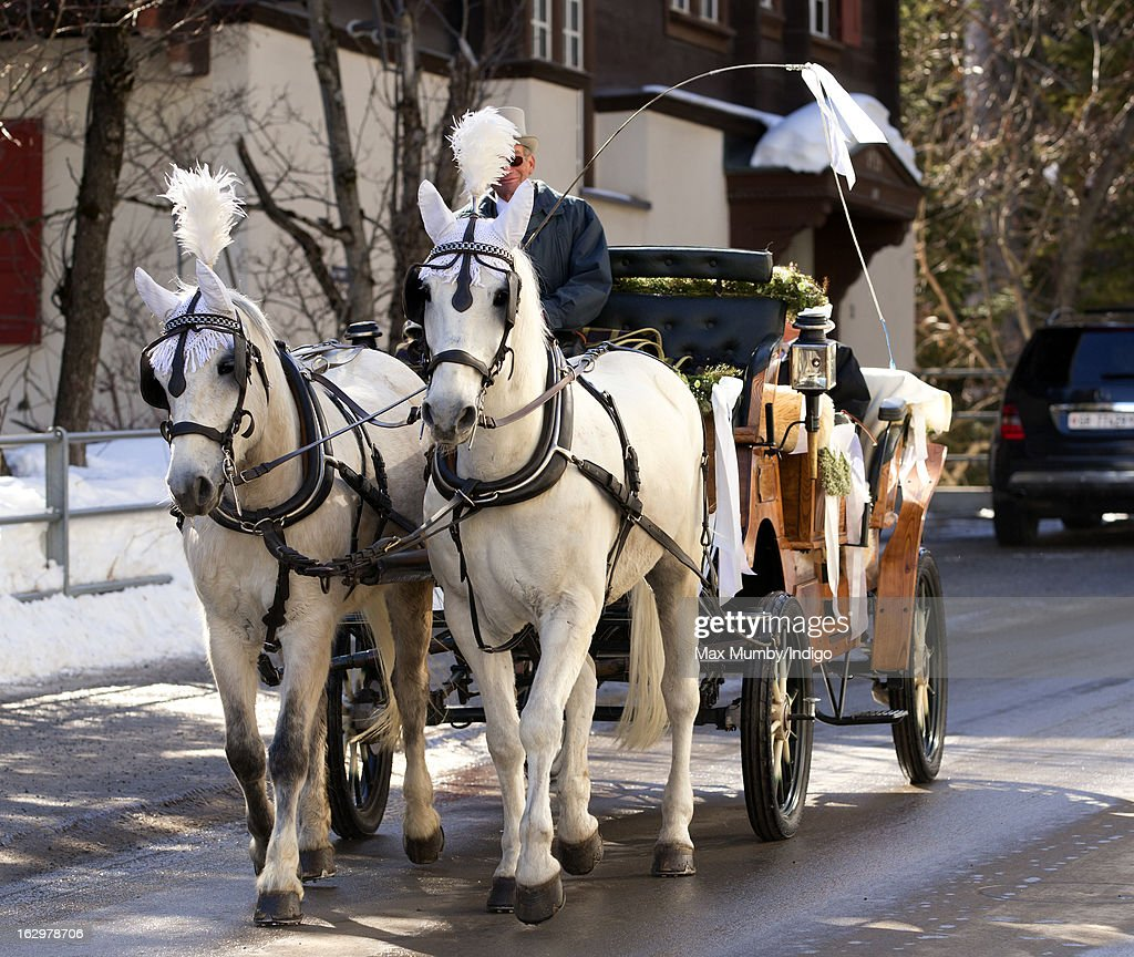 A horse drawn carriage carrying Laura Bechtolsheimer arrives at the Protestant Church for her wedding to Mark Tomlinson on March 2, 2013 in Arosa, Switzerland.