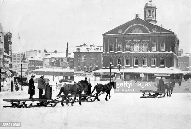 A horse drawn carriage moves through the snow passed Faneuil Hall after a 1945 winter storm