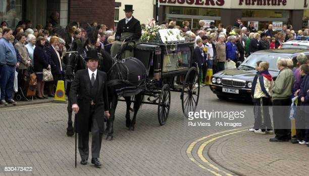 A horse drawn carriage with the coffin of Heather Tell makes its way to St Editha's Church Tamworth for her funeral The teenager's naked body was...