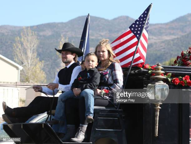 A horse drawn hurst carries the casket of Heather Lorraine Alvarado with her children on top and family members following behind through her...