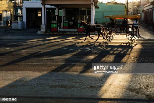 Horse drawn taxi walking on Santiago de Cuba street, Santiago, Cuba