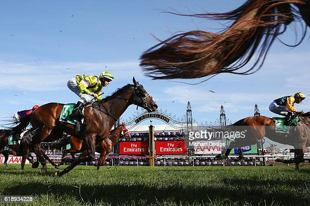 Horse finish past the post in race 9 The tabcomau Stakes on Derby Day at Flemington Racecourse on October 29 2016 in Melbourne Australia