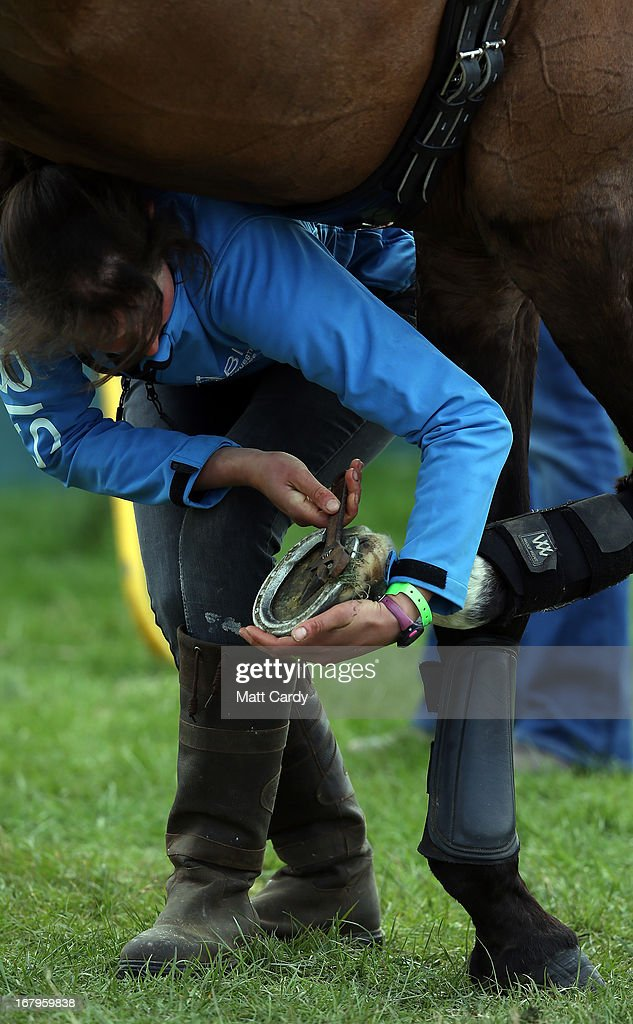A horse has its hooves looked at after completing a dressage display at the Badminton Horse Trials on the second day of the Mitsubishi sponsored event on May 3, 2013 in Badminton, Gloucestershire. The event, which runs until Monday and is held on the Duke of Beaufort's estate, is now in its 22nd year but was cancelled last year due to flooding. It is widely seen by many as one of the highlights in the equestrian eventing calendar.
