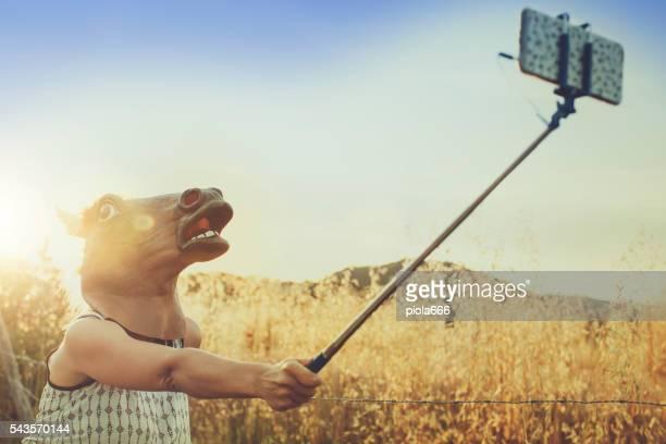 Horse head girl doing a selfie