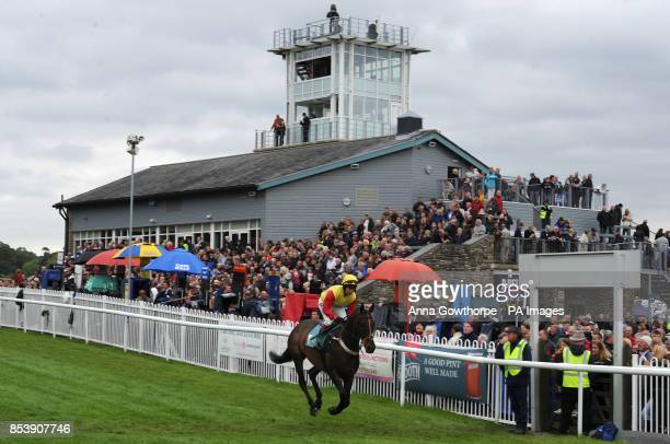 A horse is ridden to post at Cartmel Racecourse Cartmel Cumbria