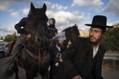 Horse mounted police disperse UltraOrthodox Jews after a scuffle with Israeli police during a protest against their military conscription outside a...