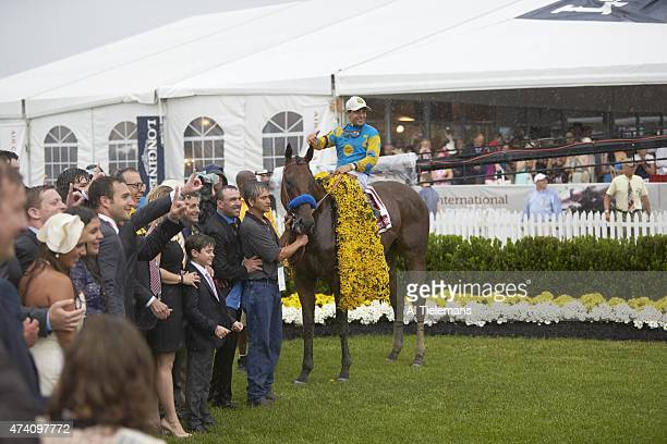 140th Preakness Stakes Jockey Victor Espinoza victorious aboard American Pharoah in Winner's Circle after winning race at Pimlico Race Course...
