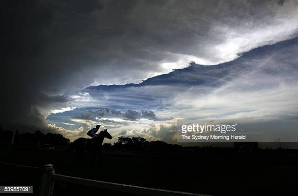 Horse Racing at Warwick Farm storm clouds loom over the track before the running of race 5 20 February 2005 SMH Picture by JENNY EVANS